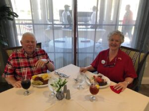 Couple having at the one of community restaurants as things return to normal.