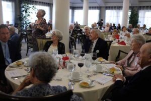 Residents dressed up and gathered in the main dining room to celebrate the community's 17th anniversary.